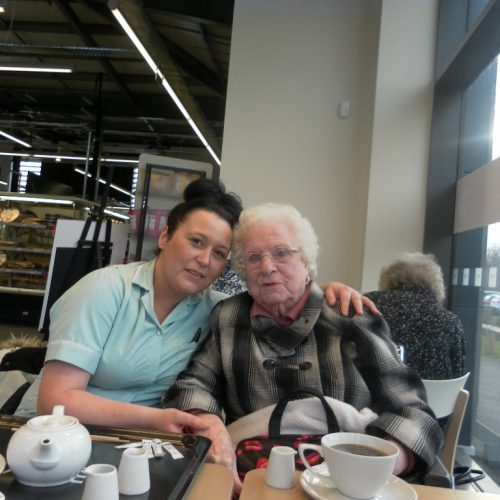 St Mary's Nursing Home resident enjoying a coffee in a cafe